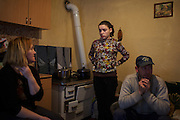 Alaksandra Todorovic, 15, talks to her parents Dosta, 41, and Dragan, 43, before going to school. She attends the High School in Strpce, the southernmost Serbian enclave in Kosovo, does not expect to go to College.
