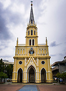 14 AUGUST 2014 - BANGKOK, THAILAND: Exteriors of the Holy Rosary Church in the Talat Noi section of Bangkok. Holy Rosary Church, Wat Mae Phra Luk Prakham, is also known as Kalawar Church. The church was built with a land grant from King Rama I in 1786, about four years after Bangkok was established as Siam's capital. Many Catholic Vietnamese and Cambodians fled to Bangkok during the wars in Indochina and adopted this church as their main house of worship. It has been rebuilt twice. The present church was built in the late 1890s. The cream-colored church has a towering spire and European style stained-glass windows.    PHOTO BY JACK KURTZ