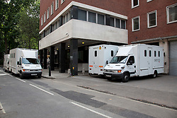 © Licensed to London News Pictures. 13/08/2011. LONDON, UK. On the day that suspected looters are put in court, prison vans are stacked waiting to be loaded at Westminster Magistrates Court. Photo credit: Matt Cetti-Roberts/LNP