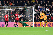 Goal - Aaron Ramsdale (12) of AFC Bournemouth is beaten as Raul Jimenez (9) of Wolverhampton Wanderers scores a goal to give a 0-2 lead to the away team  during the Premier League match between Bournemouth and Wolverhampton Wanderers at the Vitality Stadium, Bournemouth, England on 23 November 2019.