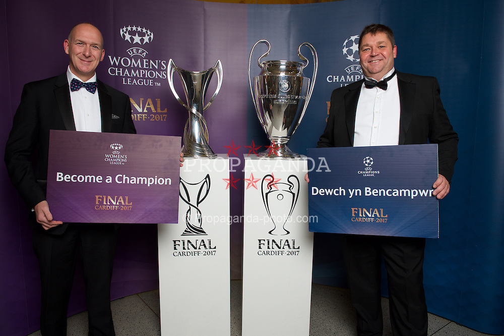 CARDIFF, WALES - Monday, December 5, 2016: Guests at the Wales Sport Awards 2016 pose with the UEFA Champions League Trophies before the ceremony at the Millennium Centre. Martin Crannis (Sportscover Europe Chief Executive) and Richard Brice (Integro Cardiff). (Pic by Ian Cook/Propaganda)