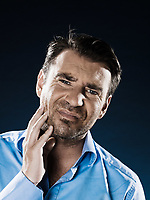 caucasian man unshaven toothache portrait isolated studio on black background
