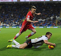 Rotherham's Scott Wootton grabs the ball as he falls to the floor. - Photo mandatory by-line: Alex James/JMP - Mobile: 07966 386802 - 06/12/2014 - SPORT - Football - Cardiff - Cardiff City Stadium  - Cardiff City v Rotherham United  - Football