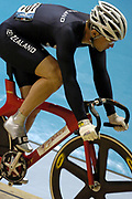 New Zealand's Justin Grace rides in the Men's Keirin on day three of the XVIII Commonwealth Games, at the Multi Purpose Arena, Melbourne, Australia, Friday, March 17 2006. Photo: Sport the Library / www.photosport.nz