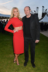 NOELLE RENO and SCOT YOUNG at the Battersea Power Station Annual Party at Battersea Power Station, 188 Kirtling Street, London SW8 on 30th April 2014.