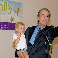 Santa Monica Mayor Bobby Shriver holds his daughter Rosemary, 18 mo., while speaking during the National Center on Addiction Substance Abuse's (CASA) Family Day - A Day to Eat Dinner with Your Children(TM) at the Santa Monica YMCA on Tuesday, September, 28, 2010