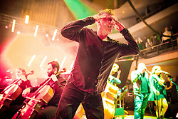"© Licensed to London News Pictures . 05/02/2016 . Manchester , UK .  "" Hacienda Classical "" debut at the Bridgewater Hall . The 70 piece Manchester Camerata and performers including New Order's Peter Hook , Shaun Ryder , Rowetta Idah , Bez and Hacienda DJs Graeme Park and Mike Pickering mixing live compositions . Photo credit : Joel Goodman/LNP"
