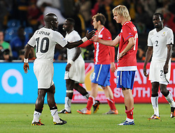Stephen Appiah  (Ghana) consoles Milos Krasic (Serbia) during the 2010 FIFA World Cup South Africa Group D match between Serbia and Ghana at Loftus Versfeld Stadium on June 13, 2010 in Pretoria, South Africa.