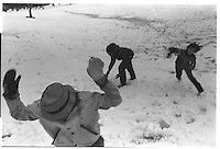 Boys in a snow fight, Riverside Park, New York City. Street photography. 1980