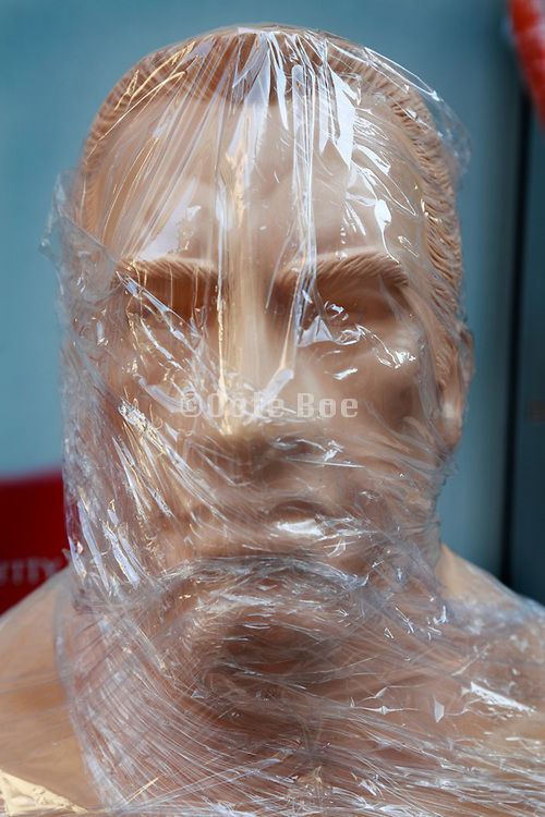 wrapped up in clear celophane boxer face punch mannequin