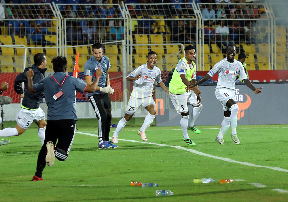 Momar Ndoye of FC Pune City celebrates the goal with the team  during match 8 of the Indian Super League (ISL) season 3 between FC Goa and FC Pune City held at the Fatorda Stadium in Goa, India on the 8th October 2016.<br /> <br /> Photo by Sandeep Shetty / ISL/ SPORTZPICS