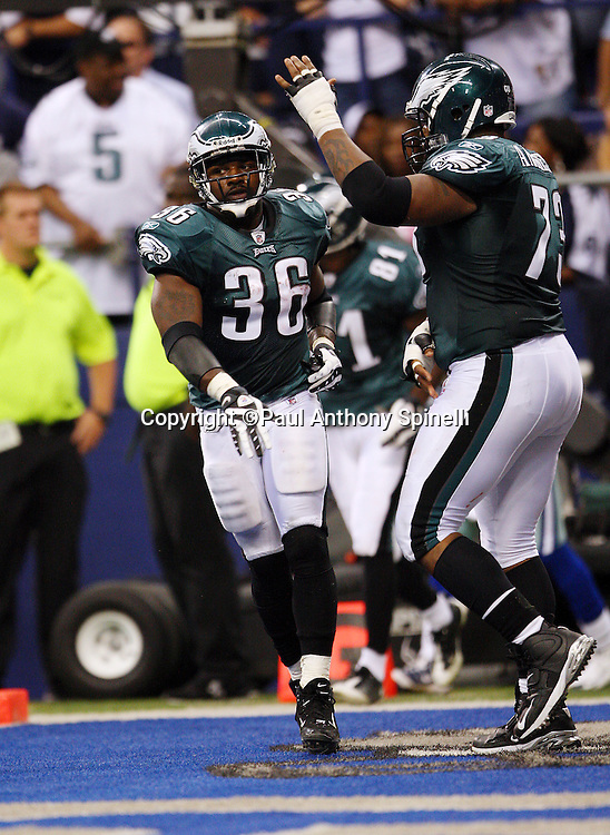 IRVING, TX - SEPTEMBER 15:  Running back Brian Westbrook #36 of the Philadelphia Eagles gets a pat on the head from teammate Shawn Andrews #73 after Westbrook catches a six yard touchdown pass in the second quarter to narrow the Dallas Cowboys lead to 14-13 at Texas Stadium on September 15, 2008 in Irving, Texas. The Cowboys defeated the Eagles 41-37. ©Paul Anthony Spinelli *** Local Caption *** Brian Westbrook;Shawn Andrews