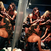 Models getting ready for the catwalk at the Millionaire Fair in Moscow. .Millionaires, billionaires and those who bought 1,000-rouble tickets were among the thousands who visited the fair held in the Crocus city expo centre. .The four-day event, held for the second year in a row, ended on October 30. The products on sale include a diamond-studded mobile phone worth a million dollars, an island, latest sports cars and other items that might appeal to the growing millionaire market..Twenty years ago, there were no official millionaires in the whole of Russia. Now Moscow has 25 billionaires and the country has 88,000 millionaires, according to Forbes Magazine. ..