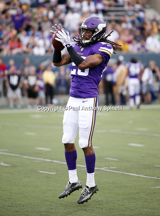 Minnesota Vikings rookie cornerback Trae Waynes (26) leaps and catches a pregame pass while warming up before the 2015 NFL Pro Football Hall of Fame preseason football game against the Pittsburgh Steelers on Sunday, Aug. 9, 2015 in Canton, Ohio. The Vikings won the game 14-3. (©Paul Anthony Spinelli)