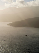 Aerial view of the Southern Ocean in the morning, with islets and the coastline of Stewart Island (Rakiura), New Zealand.