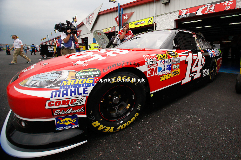 April 15, 2011; Talladega, AL, USA; NASCAR Sprint Cup Series driver Tony Stewart (14) pulls out of the garage during practice for the Aarons 499 at Talladega Superspeedway.   Mandatory Credit: Derick E. Hingle