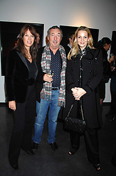 Left to right, NICK & NETTE MASON and KAREN MULVILLE at a private view of Octagan a showcase of work of photographer Kevin Lynch featuring the stars of the Ultimate Fighter Championship held at Hamiltons gallery, Mayfair, London on 17th January 2008.<br />