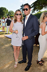CAGGIE DUNLOP and MAX BIBBY at the Summer Solstice Party during the Boodles Tennis event hosted by Beulah London and Taylor Morris at Stoke Park, Park Road, Stoke Poges, Buckinghamshire on 21st June 2014.