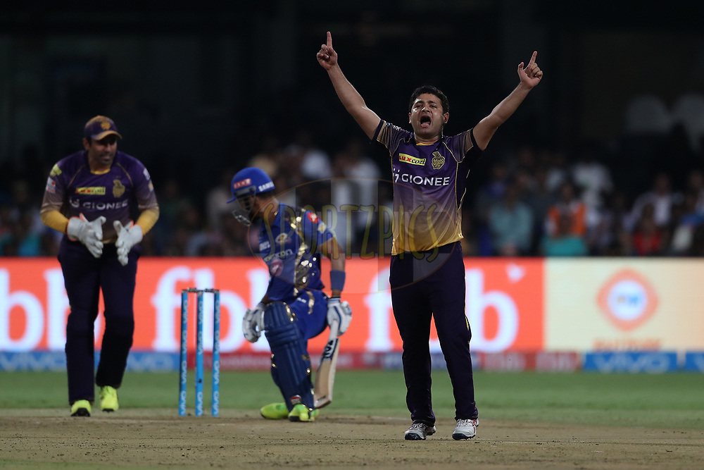 Piyush Chawla of the Kolkata Knight Riders celebrates the wicket of Lendl Simmons of the Mumbai Indians during the 2nd qualifier match of the Vivo 2017 Indian Premier League between the Mumbai Indians and the Kolkata Knight Riders held at the M.Chinnaswamy Stadium in Bangalore, India on the 19th May 2017<br /> <br /> Photo by Ron Gaunt - Sportzpics - IPL
