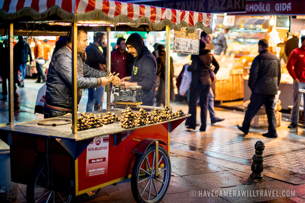 A man sells roasted chestnuts from his cart on the waterfront of the Eminonu district in Istanbul