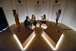 """© Licensed to London News Pictures. 29/10/2019. LONDON, UK. Staff members pose within """"I Heard There Was a Secret Chord"""", 2017, by Daily tous les jours, a participatory humming channel of people listening to Leonard Cohen's Hallelujah. Preview of """"24/7: A Wake-Up Call For Our Non-Stop World"""", a new exhibition opening on 31 October at Somerset House.  The show examines our inability to switch off from our 24/7 culture.  Over 50 multi-disciplinary works explore the pressure to produce and consume information around the clock. taking visitors on a 24-hour cycle from dawn to dusk through interactive installations.  Photo credit: Stephen Chung/LNP"""
