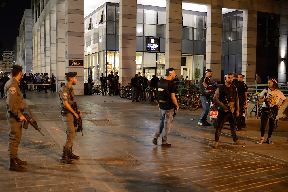Policemen are standing guard near the scene of a shooting attack in Sarona Market, Tel-Aviv on June 08'th, 2016. Four Israelis were killed and and 16 wounded in a shooting attack in Sarona Market at Tel-Aviv, performed by two Palestinian attackers. Photo by Gili Yaari.