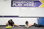 05/25/2014 - Baltimore, Md. - Jack McDermott, A14, left, and Cole Bailey, A15, stretch in the locker room before taking the field in Tufts' 12-9 win over Salisbury to win the NCAA Division III Men's Lacrosse National Championship game at M&T Bank Stadium on May 25, 2014. (Kelvin Ma/Tufts University)
