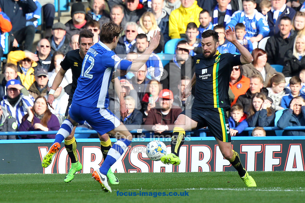 Glenn Loovens of Sheffield Wednesday and Russell Martin of Norwich in action during the Sky Bet Championship match at Hillsborough, Sheffield<br /> Picture by Paul Chesterton/Focus Images Ltd +44 7904 640267<br /> 04/03/2017