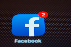 Facebook social network app close up on iPhone smart phone screen