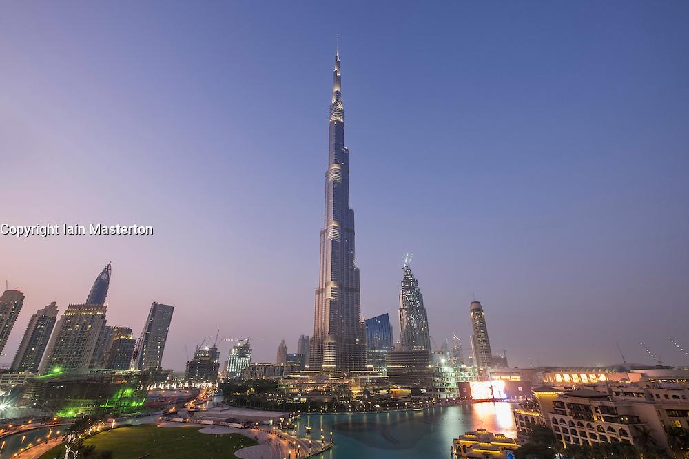 View of Burj Khalifa and lake at dusk in Downtown Dubai United Arab Emirates