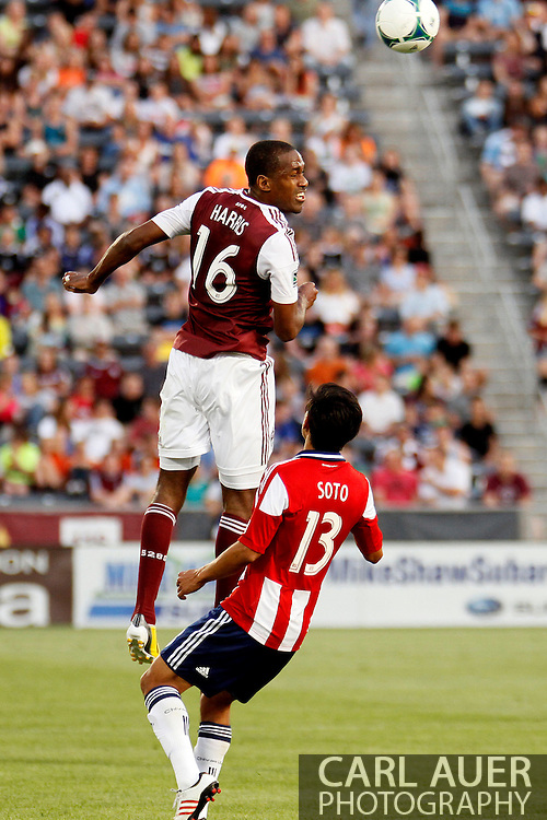 May 25th, 2013 Commerce City, CO - Colorado Rapids midfielder Atiba Harris (16) heads the ball past Chivas USA midfielder Josue Soto (13) in first half action of the MLS match between Chivas USA and the Colorado Rapids at Dick's Sporting Goods Park in Commerce City, CO