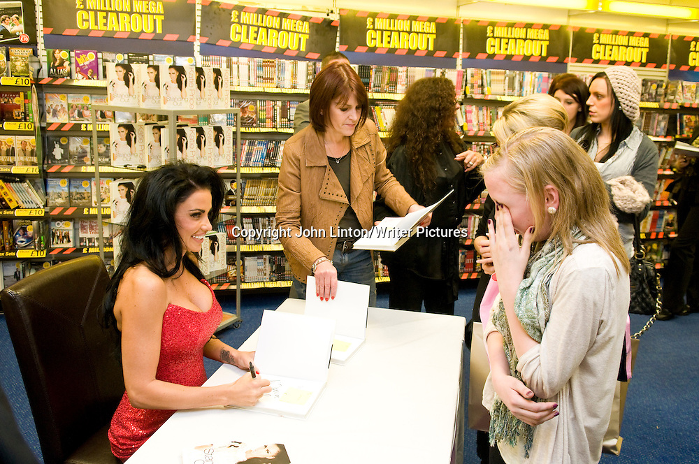 Katie Price / Jordan promoting her book 'Standing Out' in WHSmith in Glasgow, 23/10/2009. Jordan signing a copy of her book for a fan in tears.<br /> <br /> copyright John Linton/Writer Pictures<br /> contact +44 (0)20 822 41564<br /> info@writerpictures.com<br /> www.writerpictures.com