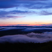 """""""Enveloped from Beyond""""<br /> <br /> Beautiful clouds and fog sweep across the top of the Blue Ridge Mountains of Virginia at sunset!!<br /> <br /> The Blue Ridge Mountains by Rachel Cohen"""
