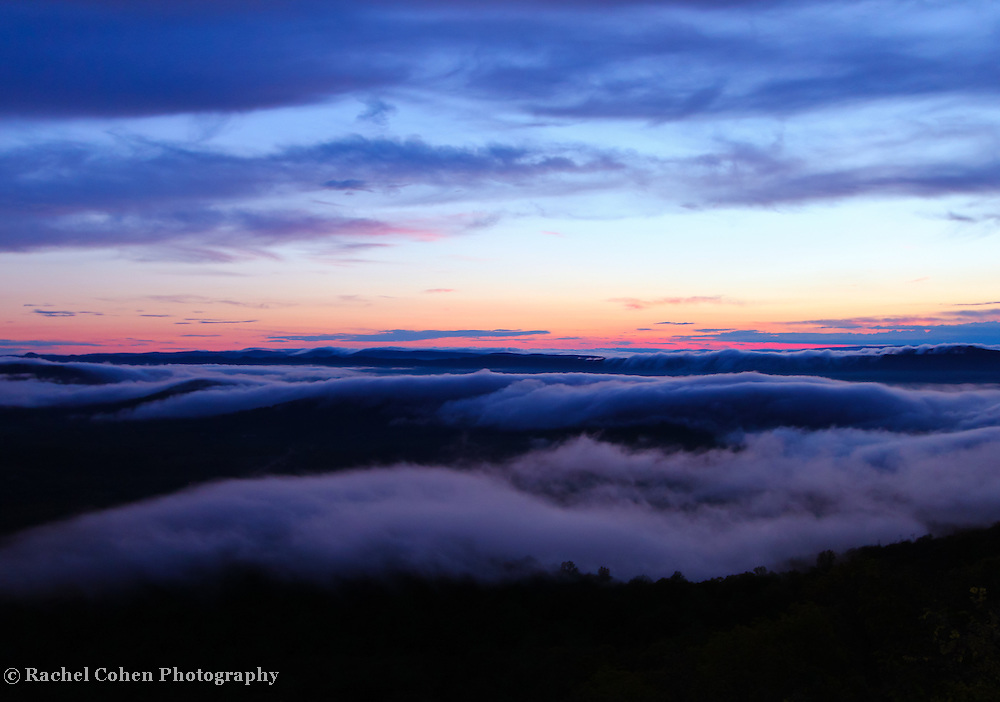 &quot;Enveloped from Beyond&quot;<br /> <br /> Beautiful clouds and fog sweep across the top of the Blue Ridge Mountains of Virginia at sunset!!<br /> <br /> The Blue Ridge Mountains by Rachel Cohen