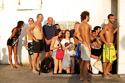 Beach goers take cover against the wall of a hotel as sirens sound warning of incoming rockets in Tel Aviv, Israel, on July 8, 2014. Sirens sounded off in a number of other cities across Israel on Tuesday night, including Israel's largest coastal city of Tel Aviv. Three rockets fired toward Tel Aviv were intercepted on Tuesday by Israel's Iron Dome anti-missile shield systems, Israeli media reported. EXPA Pictures © 2014, PhotoCredit: EXPA/ Photoshot/ JINI<br /> <br /> *****ATTENTION - for AUT, SLO, CRO, SRB, BIH, MAZ only*****