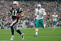 New England Patriots wide receiver Julian Edelman (11) is runs into the end zone on a 94-yard touchdown on a kick off return in the second quarter against the Miami Dolphins in the first quarter at Gillette Stadium in Foxboro, Massachusetts on January 2, 2011.    UPI/Matthew Healey