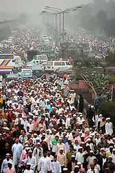 BANGLADESH TONGI 4FEB07 - Crowds on their way to the gathering  during the last day of the BiswaIjtema outside Tongi, a northern suburb of the capital city Dhaka. The annual Tablighi Jamaat Islamic movement congregation lasts three days and is attended by over two million Muslims, making it the second largest congregation after the Hajj to Mecca. Devotees from approximately 80 countries, including the host country, Bangladesh, attend the three-day Ijtema seeking divine blessings from Allah. The event focuses on prayers and meditation and does not allow political discussion. The local police estimated the number of attendees of the 2007 Ijtema to be 3 million...jre/Photo by Jiri Rezac..© Jiri Rezac 2007..Contact: +44 (0) 7050 110 417.Mobile:  +44 (0) 7801 337 683.Office:  +44 (0) 20 8968 9635..Email:   jiri@jirirezac.com.Web:    www.jirirezac.com..© All images Jiri Rezac 2007 - All rights reserved.