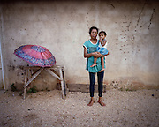 Mama Fin Imbiri (48) and her granddaughter. <br /> <br /> Mama Fin Imbiri was the first person to take Antiretroviral (ARV) in Sorong.  She is a civil servant and is open about her status despite numerous threats from her neighbors and rejection from family members
