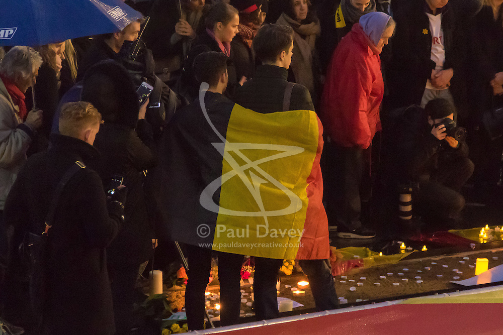 Trafalgar Square, London, March 24th 2016. People gather in London's Trafalgar Square to light candles and lay flowers in memory of those who lost their lives in the Brussels terror attacks on March 22nd in which 31 people were killed and dozens injured.