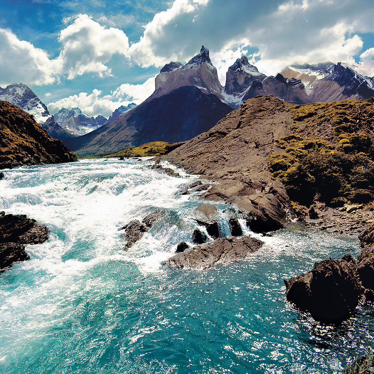 The brilliant turquoise waters of Rio del Paine rush through Torres del Paine National Park, Chile.