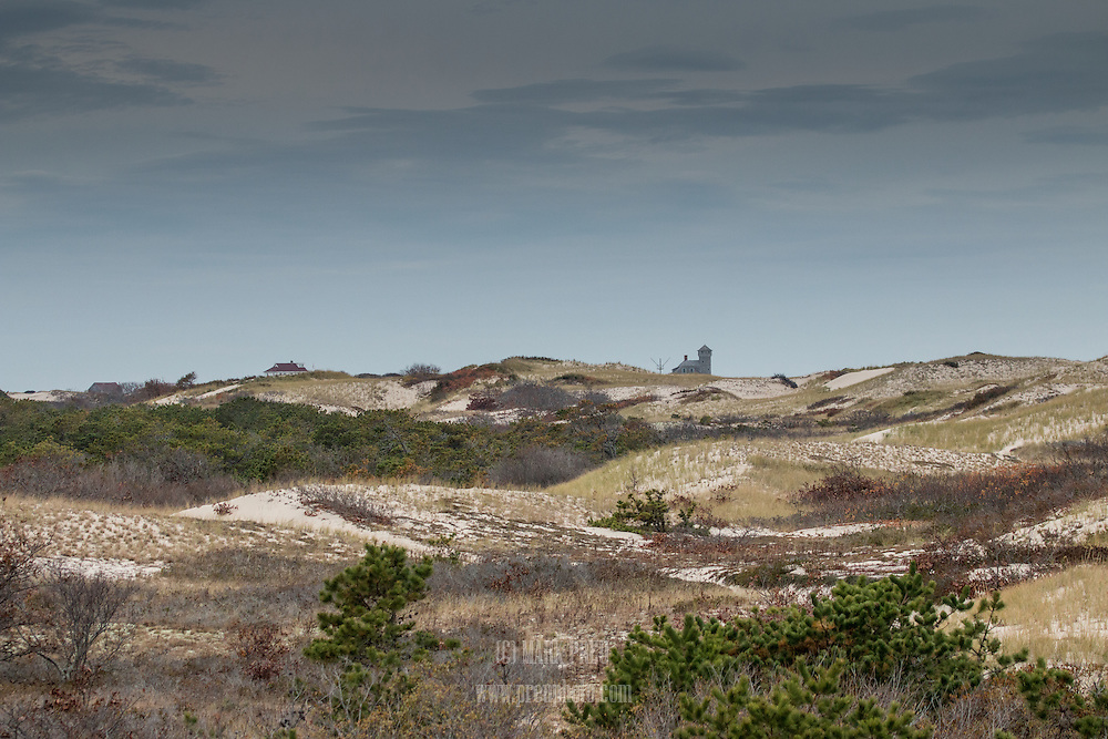 The Old Harbor Life-Saving Station peeks over teh dunes of the Provincelands area.