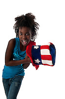 Little african american girl playing with american cap very happy.