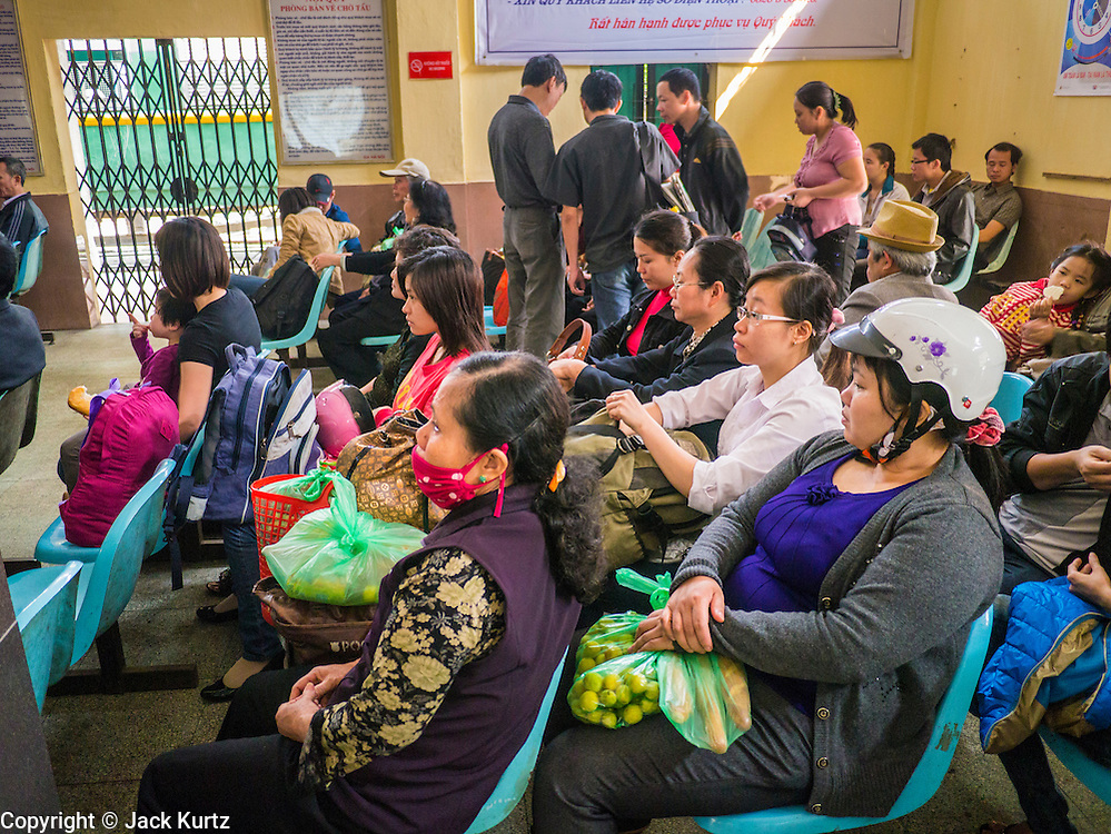 02 APRIL 2012 - HANOI, VIETNAM: Passengers wait to board a train to Hai Phong from Long Bien Train Station in Hanoi, the capital of Vietnam.    PHOTO BY JACK KURTZ