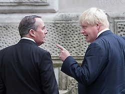 © Licensed to London News Pictures. 10/10/2017. Foreign Secretary Boris Johnson gestures to Trade Secretary Liam Fox as they walk together to the Foreign Office after attending the weekly cabinet meeting in Downing Street. London, UK. Photo credit: Peter Macdiarmid/LNP