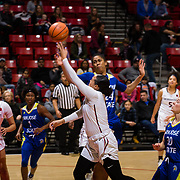 24 February 2018: The San Diego State women's basketball team closes out it's home schedule of the regular season Saturday afternoon against San Jose State. San Diego State Aztecs guard Khalia Lark (1) attempts a shot while being defended by San Jose State Spartans center Alexis Harris (24) in the first half. At halftime the Aztecs lead the Spartans 36-33 at Viejas Arena.<br /> More game action at sdsuaztecphotos.com