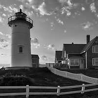 New England Black and White photography of Nobska Lighthouse at sunset. This iconic Massachusetts lighthouse is located near Woods Hole Village in Falmouth, MA on Cape Cod.<br />