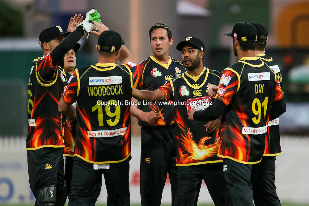 The Wellington Firebirds celebrate a wicket during the Georgie Pie Super Smash T20 cricket match - SKYCITY Northern Knights v Wellington Firebirds on Thursday 12 November 2015 at Seddon Park, Hamilton. Copyright Photo:  Bruce Lim / www.photosport.nz