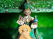 31 JANUARY 2018 - LEGAZPI, ALBAY, PHILIPPINES: A statue of El Santo Niño, the Baby Jesus, in a tricycle taxi in Legazpi, Philippines. The Philippines are the only Catholic majority country in Southeast Asia.        PHOTO BY JACK KURTZ