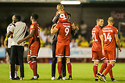 Gabriele Cioffi, Head Coach of Crawley Town FC celebrates the win with Ollie Palmer (Crawley Town)  following the EFL Cup match between Crawley Town and Norwich City at The People's Pension Stadium, Crawley, England on 27 August 2019.