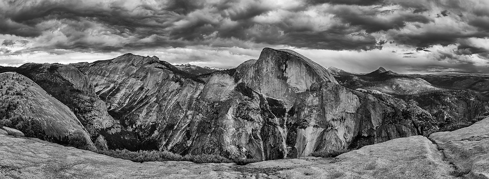 Black and white Panorama of Half Dome and Clouds Rest seen from North Dome, Yosemite National Park, California